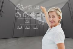 Businesswoman is drawing against data center background. Digital composite of model drawing in server room Stock Photography