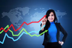 Businesswoman is drawing arrow upward Royalty Free Stock Image