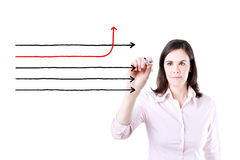 Businesswoman drawing arrows in different directions. Stock Photo