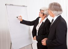 Businesswoman drawing a bar graph Stock Images