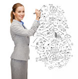 Businesswoman drawing big plan with marker Stock Photography