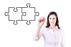 Businesswoman drawing a Blank Puzzle on the screen. Stock Photo