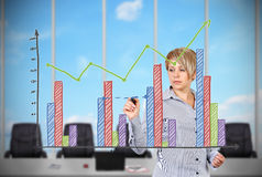 Businesswoman drawing chart Stock Photo