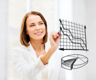 Businesswoman drawing charts in the air Royalty Free Stock Photography