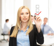 Businesswoman drawing checkmark on virtual screen Royalty Free Stock Image