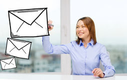Businesswoman drawing envelope Stock Images