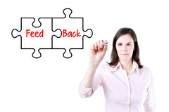 Businesswoman drawing a Feedback puzzle concept on the virtual screen. Stock Images