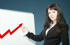 Businesswoman drawing graph Stock Image