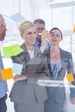 Businesswoman drawing graph on the board Royalty Free Stock Image