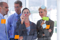 Businesswoman drawing graph on the board Stock Photos