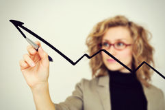 Businesswoman drawing graph with pen Royalty Free Stock Image