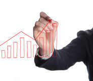 Businesswoman drawing graph Royalty Free Stock Photo
