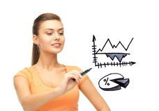 Businesswoman drawing graphs in the air Royalty Free Stock Photography