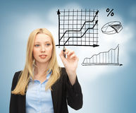Businesswoman drawing graphs in the air Stock Images