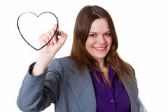Businesswoman drawing a heart Stock Photography