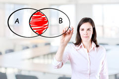Businesswoman drawing intersected circle diagram. Stock Images
