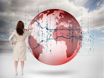 Businesswoman drawing a key over a red planet Royalty Free Stock Image