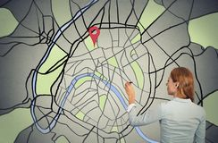 Businesswoman drawing on a map Royalty Free Stock Images