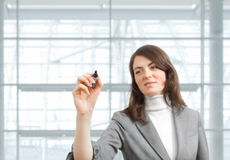 Businesswoman drawing with marker Stock Photos
