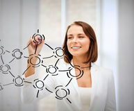 Businesswoman drawing network contacts Royalty Free Stock Photography