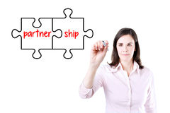Businesswoman drawing a Partnership Puzzle Concept on the virtual screen. Stock Photos