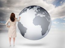 Businesswoman drawing on a planet Stock Photos