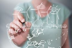 Businesswoman drawing renewable energy sketch. Businesswoman on blurred background drawing renewable energy sketch Stock Photos