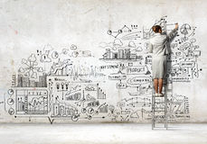 Businesswoman drawing sketch Stock Image