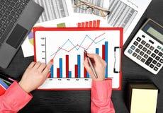 Businesswoman drawing stock chart Stock Image