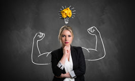 Businesswoman with drawing symbolizing power. And having an idea Royalty Free Stock Photo