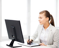 Businesswoman with drawing tablet in office Royalty Free Stock Photography
