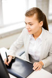 Businesswoman with drawing tablet in office Stock Photo