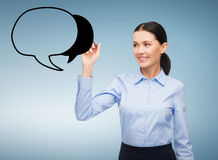 Businesswoman drawing text bubble in the air Royalty Free Stock Image
