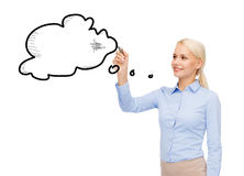 Businesswoman drawing text bubble with a marker Stock Photography
