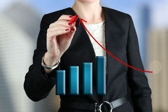 Businesswoman  drawing a virtual  graph Stock Photography