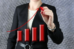 Businesswoman  drawing a virtual  graph Royalty Free Stock Photography