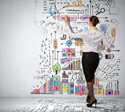 Businesswoman drawing on wall Stock Images
