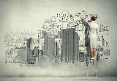 Businesswoman drawing on wall Royalty Free Stock Photos