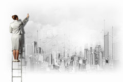 Businesswoman drawing on wall Royalty Free Stock Photography