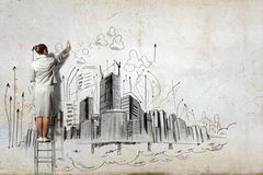 Businesswoman drawing on wall Stock Image