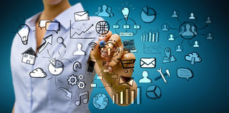 Businesswoman drawing web icons Stock Photo