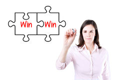 Businesswoman drawing a Win Win Puzzle Concept on the virtual screen. Stock Image