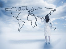 Businesswoman drawing a world map Stock Photography