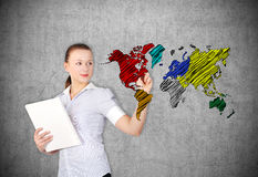 Businesswoman drawing world map Royalty Free Stock Photo