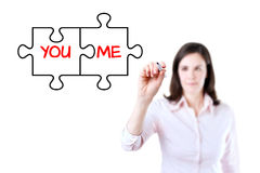 Businesswoman drawing a You and Me puzzle love concept on the virtual screen. Isolated on white. Stock Image