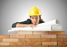 Businesswoman with drawings near brick wall Royalty Free Stock Images