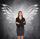Businesswoman with drawn butterfly wings Royalty Free Stock Image