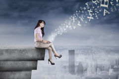 Businesswoman dreaming on the rooftop Royalty Free Stock Photo