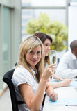 Businesswoman drinking champagne Royalty Free Stock Photography
