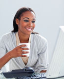 Businesswoman drinking a coffee Stock Images